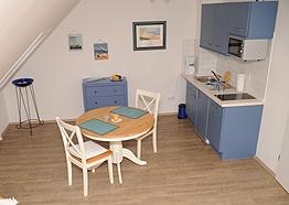 Wohnküche der Insel-Suite - Hotel Friesenhuus Greetsiel